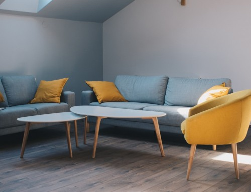 two-wooden-white-coffee-table-and-grey-fabric-sofa-inside-living-room.jpg