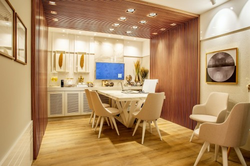 white-table-set-whith-chair-on-wooden-floor-and-painting-on-wall-inside-dining-room-photo.jpg
