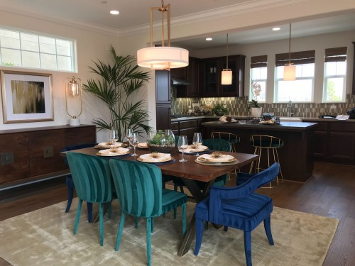 blue-and-brown-wooden-table-and-blue-and-green-chairs-and-white-round-lamp-above-the-table-near-kitchen-counter-near-dining-set-photo.jpg