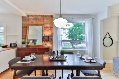 brown-wooden-table-with-aramless-chairs-near-table-and-white-window-inside-dining-room-photo.jpg