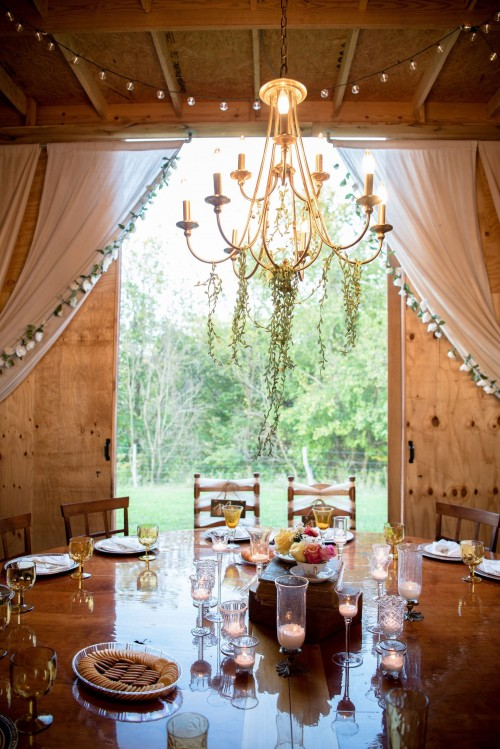 fine-dining-under-gold-chandelier-photo-near-window-with-white-curtain-inside-dining-room-photo.jpg