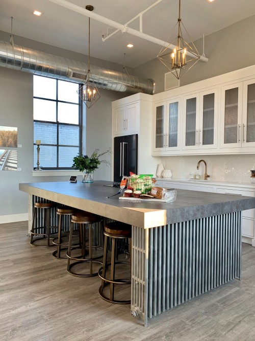 gray-metal-island-table-near-white-wooden-kitchen-cabinet-and-stainless-faucent-on-it-and-white-drawers-on-kitchen-counter-photo.jpg
