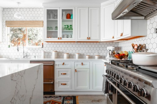 kitchen-house-area-photo-and-kitchen-iteams-on-kitchen-counter-and-white-drowers-and-shelf-on-white-wall-photo.jpg