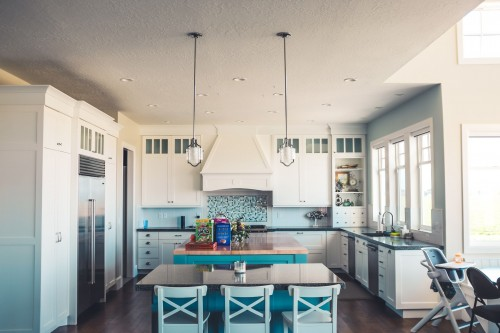 kitchen-with-island-and-dining-set-inside-kitchen-and-hanging-lamp-above-the-room-inside-kitchen.jpg