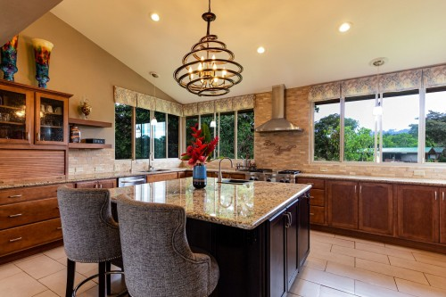 square-beige-granite-table-and-gray-fabric-sofa-aramless-chairs-and-modern-designed-hanging-lamp-above-counter-inside-kitchen-room.jpg