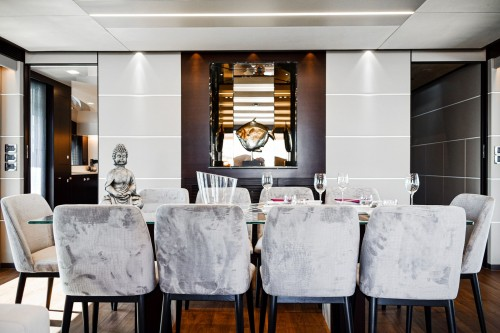white-table-cloth-on-table-and-white-fabric-aramless-white-and-black-chair-around-the-dining-room-photo.jpg