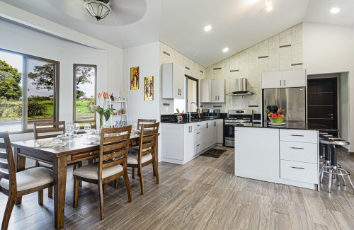 white-wooden-kitchen-cabinet-and-white-wooden-kitchen-cabinet-near-white-kitchen-counter-inside-dining-room.jpg
