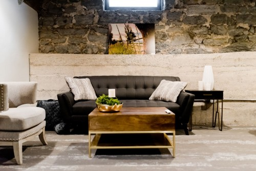 gray-couch-and-brown-wooden-table-with-black-and-white-sofa-with-natural-painting-on-wall.jpg
