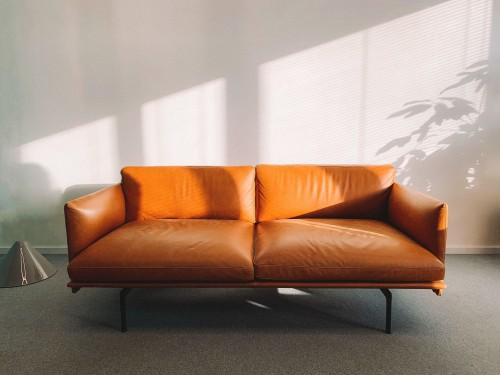 2-seat-Orange-Leather-Sofa-Beside-Wall.jpg