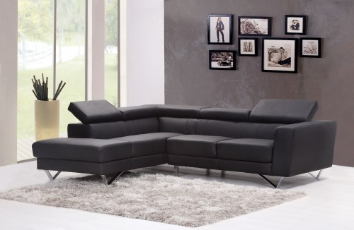 Black-Fabric-Sectional-Sofa-with-white-carpet-Near-Glass-Window.jpg