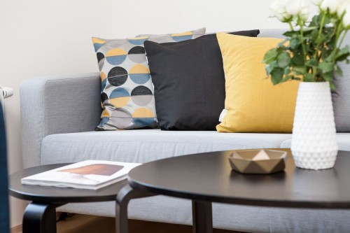 Centerpiece-on-Coffee-Table-Beside-Sofa-With-Three-Pillows.jpg