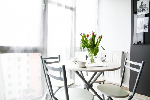 Empty-Chairs-Beside-Table-With-Tulip-Flowers.jpg
