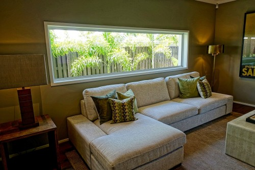 Gray-Sectional-Couch-near-glass-window.jpg