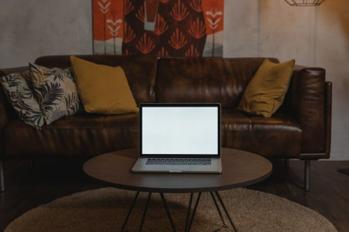 Macbook-Pro-on-Brown-Wooden-Round-Table-with-brown-sofa.jpg