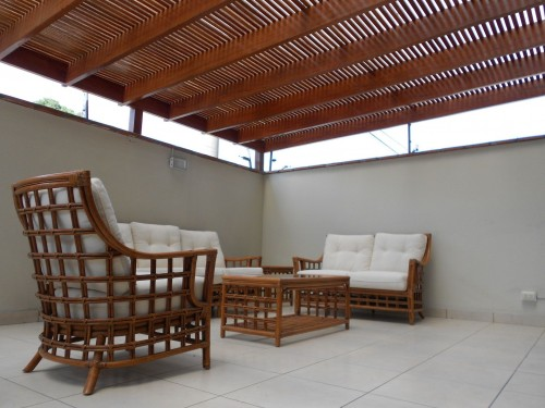 Rectangular-Brown-Rattan-Coffee-Table-with-white-wooden-chairs-in-Home.jpg