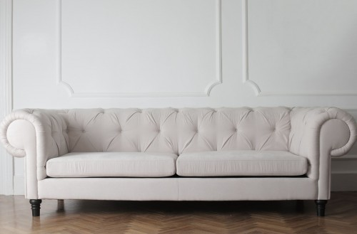 White-Couch-On-Wooden-Floor-beside-white-wall.jpg