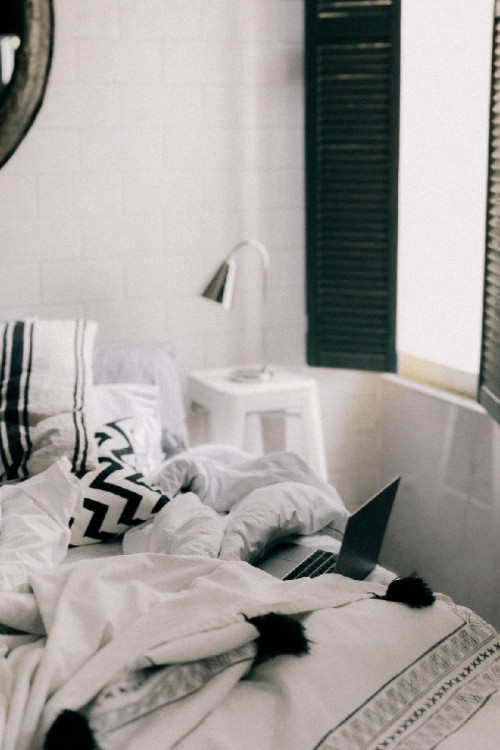 Bedroom decor ideas || Cozy bedroom interior design ideas cabin shutters stretched canvas and table lamp beside bed