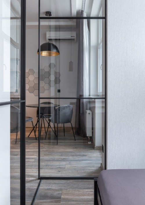 Modern dining room interior design steel frame doors with glass and gray velvet occasional chair